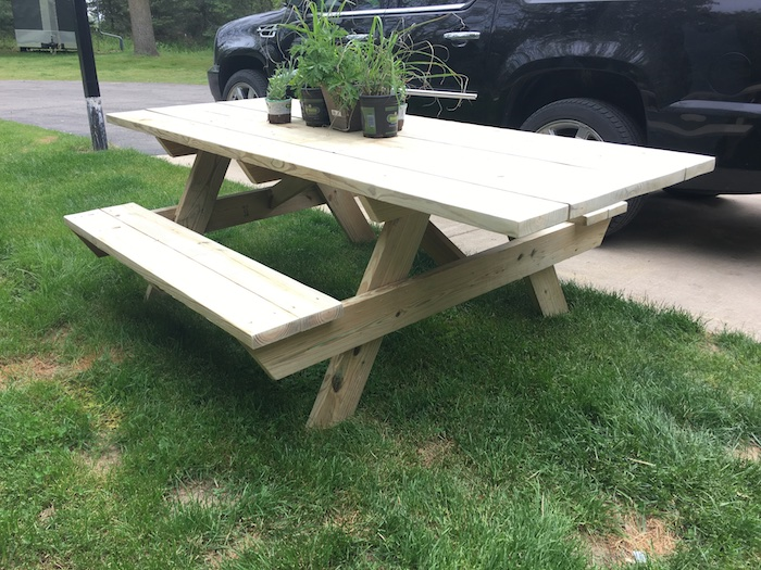 A picnic table with ample space for a wheelchair on the end.